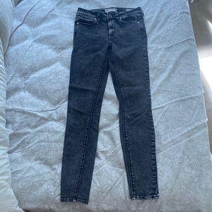 Black acid wash skinny jeans